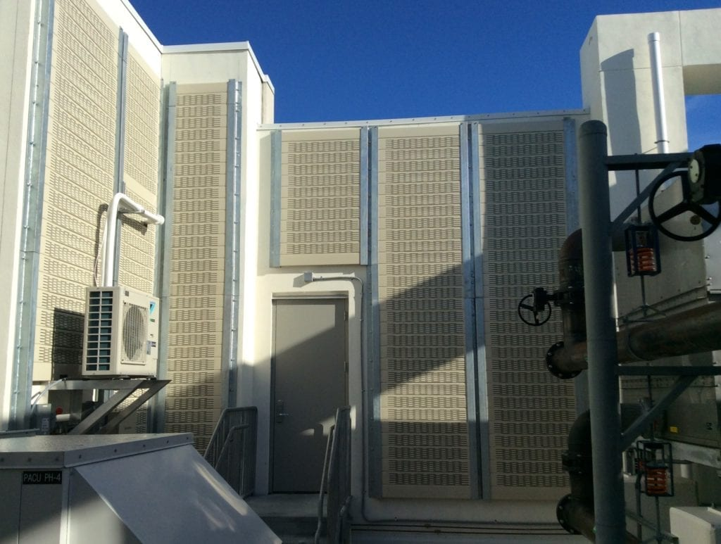 Rooftop mechanical yard walls clad with Silent Protector Absorptive system